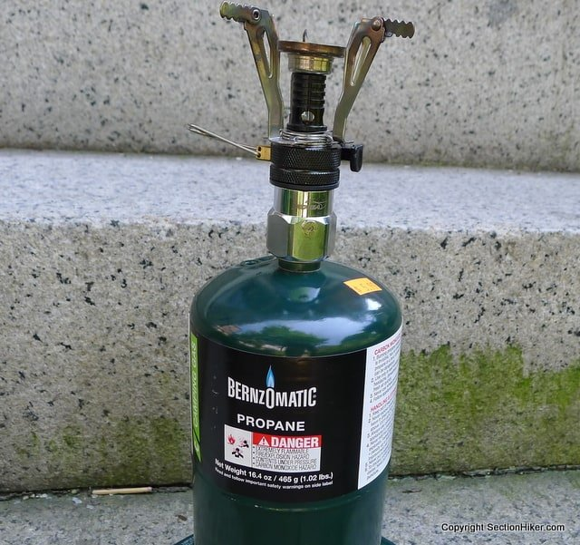 Backpacking Canister Stove, Kovea LPG Adapter, and a Coleman style Propane Fuel Canister