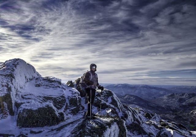 Hiker on the windy summit of Mt. Marcy
