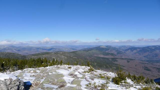 Views from South Baldface of Evans Notch, Mahoosuc Range, and mountains beyond in Maine
