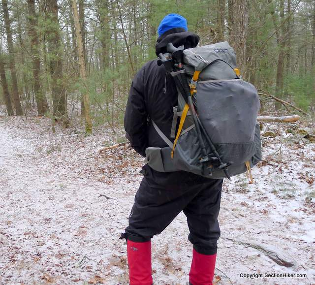 Gossamer Gear Gorilla - When using the trekking pole holders, slip the tops of your poles under the upper compression strap to hold them in place.