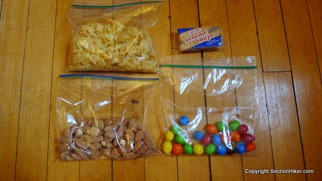 High calorie food and removal of excess packaging can significantly reduce the weight of the food you need to carry.