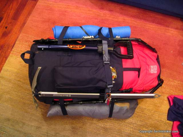 Climbing style backpacks, often used in winter, often have special ice axe or crampon pockets that allow you to attach sharply pointed gear on the outside of your backpack. Pack shown - Cold Cold World Chaos