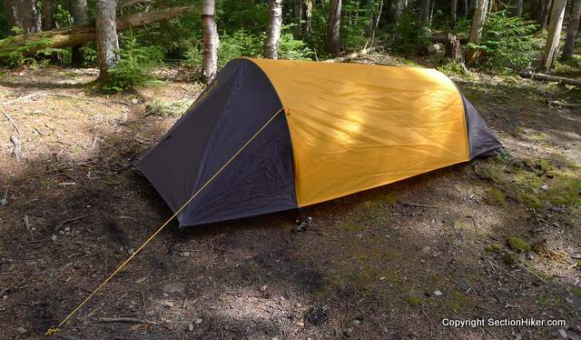 The Eureka Solitaire is a bivy style tent erected with two arched poles.