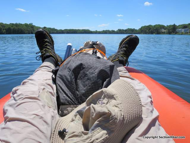 I prefer paddling with my backpack between my legs because I feel its more stable