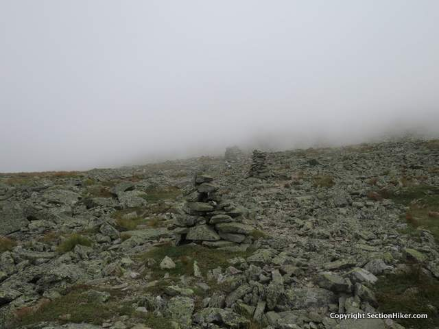 Its not uncommon to encounter dense fog when climbing Mt Washington, even on days when brilliant sunshine is forecast