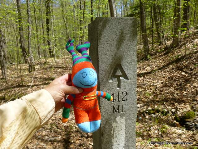 Maggie poses at the milepost