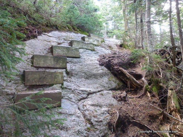 Wooden steps bolted to rock on Wildcat E.