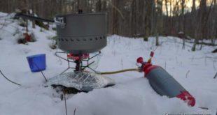 Melting snow with a MSR Whisperlite Stove