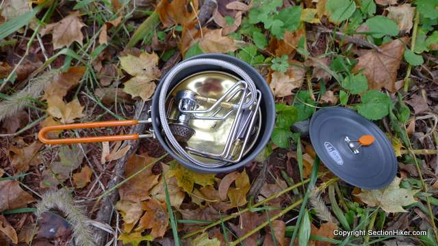 The Kovea Spider is compact enough to fit inside a 1.1 liter pot with a large gas canister and a wind screen.