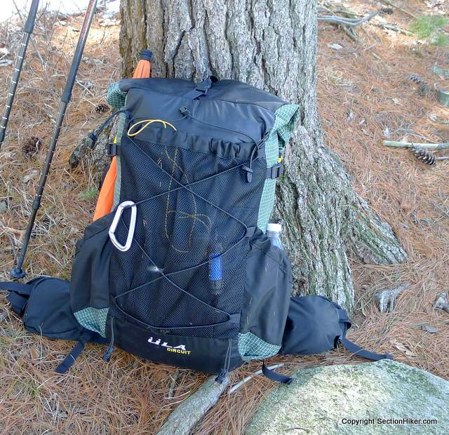 The ULA Circuit is organized like most lightweigh and ultralight backpacks with a rear mesh pocket and open side water bottle pockets.