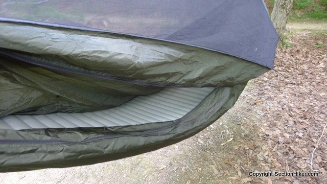 The double layer hammock has an internal sleeve which can hold a foam or inflatable pad for more back insulation.