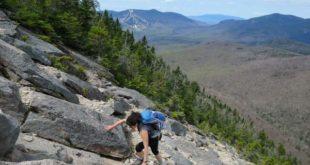 Lisa scrambles up the North Tripyramid Slide