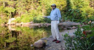 Full body fishing sun protection on Flat Mountain Pond - hat, sunglasses, neck buff, fishing gloves, long sleeve shirt and long pants