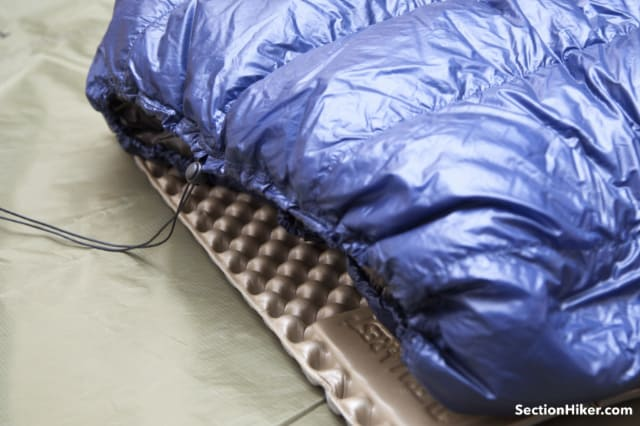 A drawstring closes the top of the quilt around your shoulders and neck.