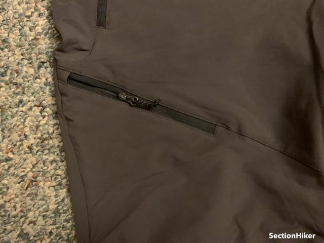 Knee Slash Pocket Zipper Closup - the knee pocket is large enough to hold a Apple Smartphone.