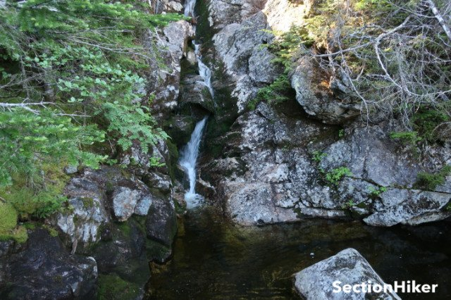 Tall waterfall and deep pool near the bottom of the Sphinx Trail