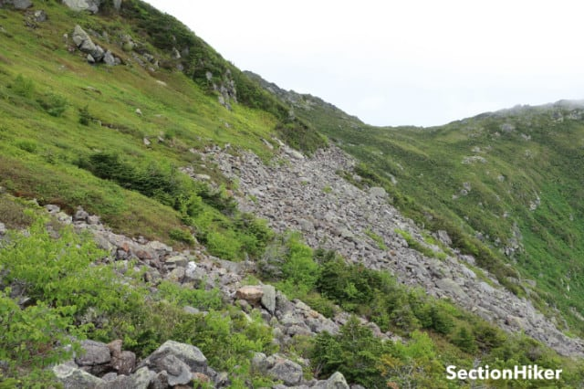 The Edmands Col Cutoff Trail crosses this rocky hillside.