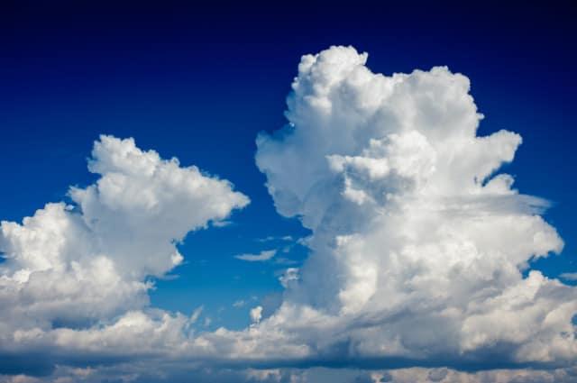 Double cumulonimbus cloud in a deep blue sky